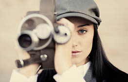 Woman holding a Super 8mm film camera