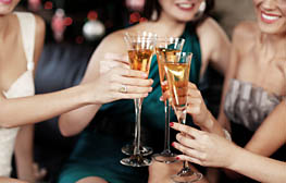 People holding cocktail glasses